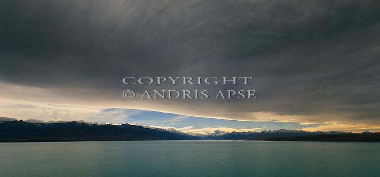 Menacing cloud over Lake Pukaki. Canterbury New Zealand.