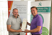 Nearest the 14th pin sponsor Air IT's Simon Leadley with winner Nigel Johnson