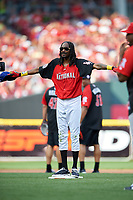 Rapper Snoop Dogg signals safe while standing on second base during the All-Star Legends and Celebrity Softball Game on July 12, 2015 at Great American Ball Park in Cincinnati, Ohio.  (Mike Janes/Four Seam Images)