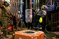 Workers prepare to drill into the permafrost at a well in Novy Urengoi, Siberia. The drill bit, embedded with diamond discs along the cutter, costs around 50,000 Euros each. It is forced down by a 10-ton load and turns at up to 200 revs per minute. /Felix Features