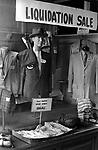 Liquidation Sale going out business closing, down mans clothes shop. Manhattan, New York , 1969, USA