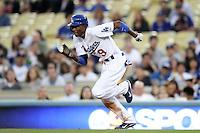 Los Angeles Dodgers shortstop Dee Gordon #9 runs the bases against the Cincinnati Reds at Dodger Stadium on June 14, 2011 in Los Angeles,California. (Larry Goren/Four Seam Images)