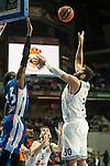 Real Madrid´s Ioannis Bourousis and Anadolu Efes´s Stephane Lasme during 2014-15 Euroleague Basketball match between Real Madrid and Anadolu Efes at Palacio de los Deportes stadium in Madrid, Spain. December 18, 2014. (ALTERPHOTOS/Luis Fernandez)