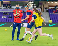 ORLANDO, FL - JANUARY 22: Vlatko Andonovski watches Julie Ertz #8 and Rose Lavelle #16 of the USWNT warm up before a game between Colombia and USWNT at Exploria stadium on January 22, 2021 in Orlando, Florida.