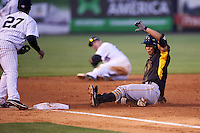 Bradenton Marauders third baseman Connor Joe (6) slides into third as Miguel Andujar (27) waits for a throw during a game against the Tampa Yankees on April 11, 2016 at George M. Steinbrenner Field in Tampa, Florida.  Tampa defeated Bradenton 5-2.  (Mike Janes/Four Seam Images)