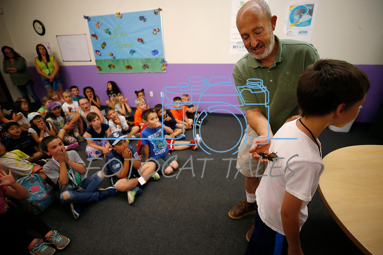 Gabe Kerschner, with Conservation Ambassadors, shows off Madagascar hissing cockroaches during a presentation at the Boys & Girls Club of Western Nevada in Carson City, Nev., on Tuesday, June 12, 2018 as part of the Carson City Library's Summer Learning Challenge. <br /> Photo by Cathleen Allison/Nevada Momentum