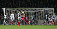 Goalkeeper Matt Ingram of Wycombe Wanderers pulls off a late save during the Sky Bet League 2 match between Wycombe Wanderers and Portsmouth at Adams Park, High Wycombe, England on 28 November 2015. Photo by Andy Rowland.