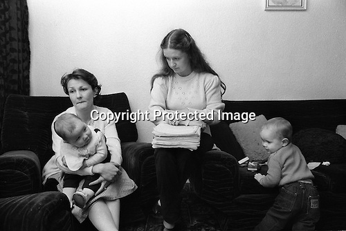 Derry Northern Ireland Londonderry. 1983. Ann Doherty and Marie McSheffrey with their children. With papers work that concerns their husbands future trials. They have help from CAST, Campaign Against Show Trials.  <br /> <br /> I am not sure of the history of these men, it needs to be looked up. I think they their husbands were implicated by a supergrass.
