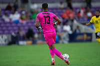 ORLANDO, FL - JULY 20: Dillon Barnes #13 of Jamaica kicks the ball during a game between Costa Rica and Jamaica at Exploria Stadium on July 20, 2021 in Orlando, Florida.