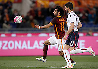 Calcio, Serie A: Roma vs Bologna. Roma, stadio Olimpico, 11 aprile 2016.<br /> Roma's Mohamed Salah, left, is chased by Bologna's Luca Rossettini during the Italian Serie A football match between Roma and Bologna at Rome's Olympic stadium, 11 April 2016.<br /> UPDATE IMAGES PRESS/Isabella Bonotto