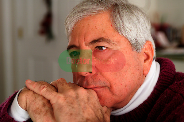 elderly man looking off in confusion, forgetfulness