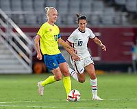 TOKYO, JAPAN - JULY 21: Caroline Seger #17 of Sweden dribbles during a game between Sweden and USWNT at Tokyo Stadium on July 21, 2021 in Tokyo, Japan.