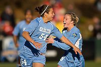 North Carolina Tar Heels forward Casey Nogueira (54) celebrates scoring her first goal with teammate defender Rachel Givan (16). The North Carolina Tar Heels defeated the Notre Dame Fighting Irish 2-1 during the finals of the NCAA Women's College Cup at Wakemed Soccer Park in Cary, NC, on December 7, 2008. Photo by Howard C. Smith/isiphotos.com