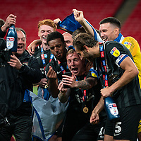 Nicky Adams of Northampton Town celebrates with teammates on his phone during the Sky Bet League 2 PLAY-OFF Final match between Exeter City and Northampton Town at Wembley Stadium, London, England on 29 June 2020. Photo by Andy Rowland.