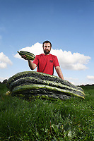 BNPS.co.uk (01202 558833)<br /> Pic: ZacharyCulpin/BNPS<br /> <br /> Mark Baggs with the massive marrow<br /> <br /> A farmer is celebrating after growing a record-breaking marrow, which tips the scales at more than 200lbs.<br /> <br /> Mark Baggs' marrow is the biggest ever grown in Britain and the second heaviest in the world.<br /> <br /> Weighing in at 200lbs 6ozs Mark's marrow is just six pounds short of the current world record that was grown in Holland in 2009.