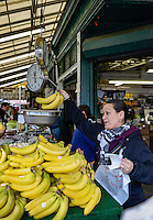 Woman selling fruit in the Italian Market, Philadelphia, Pennsylvania, USA