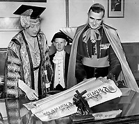 Visite de la Princesse Mary, 1955<br /> <br /> The Princess Royal visited Laval university at Quebec yesterday on her tour of Canada and here she examines the university charter which was granted by Queen Victoria, 1955<br /> <br /> <br /> PHOTO :  Norman JAMES - Toronto Star Archives - AQP