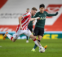 23rd December 2020; Bet365 Stadium, Stoke, Staffordshire, England; English Football League Cup Football, Carabao Cup, Stoke City versus Tottenham Hotspur; Nathan Collins of Stoke City crosses the ball in front of Son Heung-min of Tottenham Hotspur