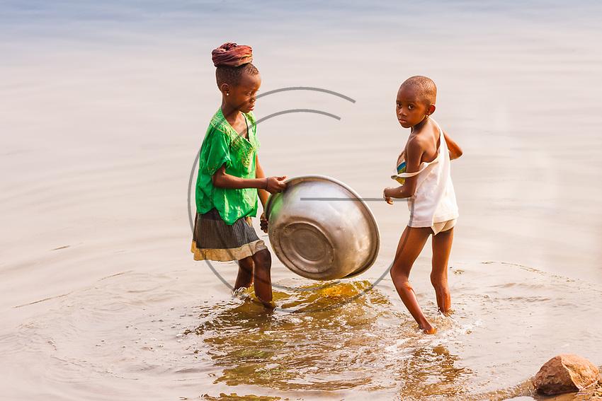 Africa, Ghana, black children wash in the river