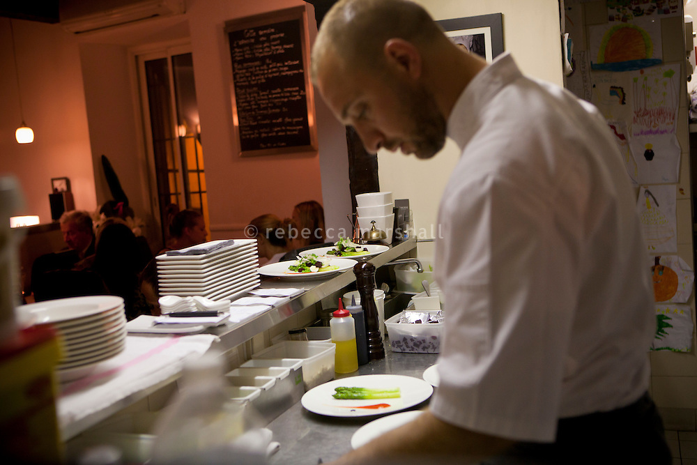 Chef Laurent Parrinello prepares dishes in the open kictchen at his restaurant 'L'Armoise'. Antibes, France, 07 April 2012
