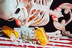 Skeleton illustration drug addiction problem with drugs, money, prescriptions, pills, flag and backlight.