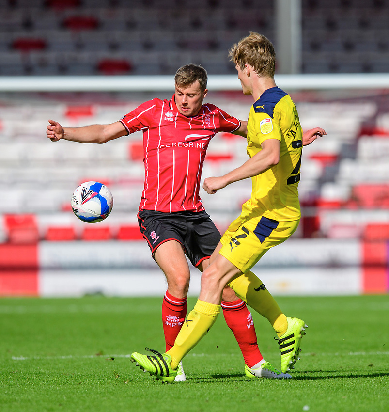 Lincoln City's James Jones vies for possession with Oxford United's Rob Atkinson<br /> <br /> Photographer Chris Vaughan/CameraSport<br /> <br /> The EFL Sky Bet League One - Saturday 12th September 2020 - Lincoln City v Oxford United - LNER Stadium - Lincoln<br /> <br /> World Copyright © 2020 CameraSport. All rights reserved. 43 Linden Ave. Countesthorpe. Leicester. England. LE8 5PG - Tel: +44 (0) 116 277 4147 - admin@camerasport.com - www.camerasport.com - Lincoln City v Oxford United