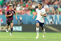 DENVER, CO - JUNE 6: Tyler Adams #4 of the United States moves off the ball during a game between Mexico and USMNT at Mile High on June 6, 2021 in Denver, Colorado.