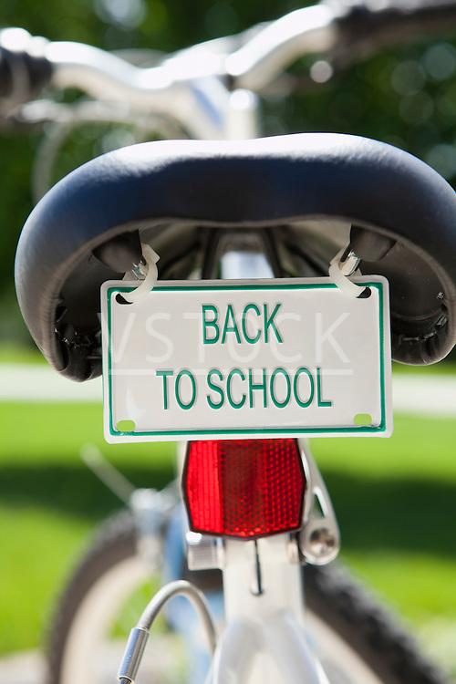 USA, Illinois, Metamora, Bicycle with 'back to school' sign