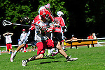 BERLIN, GERMANY - JUNE 22: Round Robin match of LCC Radotin (red) vs Team Poland (white) during the Berlin Open Lacrosse Tournament 2013 at Stadion Lichterfelde on June 22, 2013 in Berlin, Germany. Final score 6-6. (Photo by Dirk Markgraf/www.265-images.com)