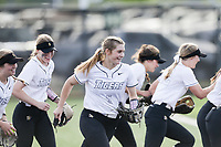 Bentonville players react, Thursday, April 29, 2021 during a softball game at Bentonville High School in Bentonville. Check out nwaonline.com/210430Daily/ for today's photo gallery. <br /> (NWA Democrat-Gazette/Charlie Kaijo)