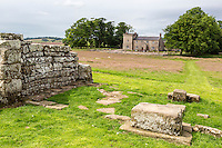 Cumbria, England, UK.  Birdoswald Fort, Hadrian's Wall Footpath. Victorian-era house seen from the southern gate entrance of the fort.