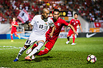 Yaseen Bakheet of Jordan (L) fights for the ball with Lee Chi Ho of Hong Kong (R) during the International Friendly match between Hong Kong and Jordan at Mongkok Stadium on June 7, 2017 in Hong Kong, China. Photo by Marcio Rodrigo Machado / Power Sport Images