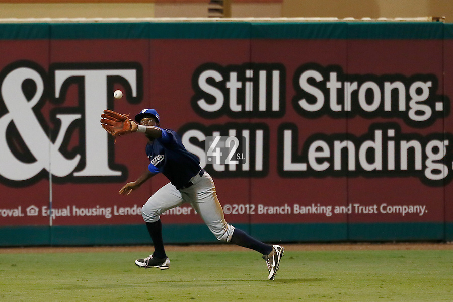 20 September 2012: Frederic Hanvi eyes the ball as he makes the catch during Spain 8-0 win over France, at the 2012 World Baseball Classic Qualifier round, in Jupiter, Florida, USA.