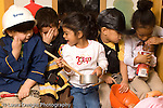 Preschool  3 year olds pretend play and dressup group playing horizontal