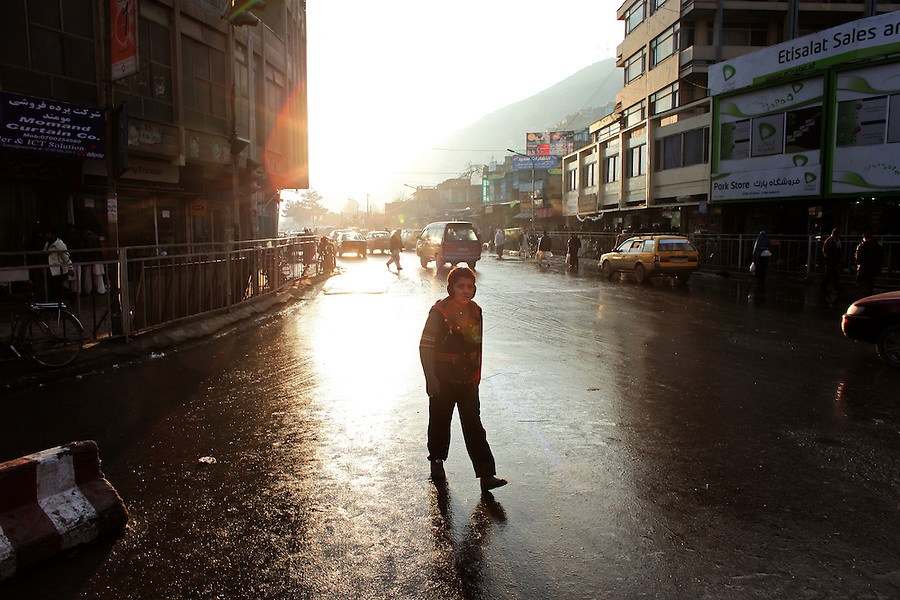 A young boy walks through central Kabul on a rainy winter day in late December 2008.