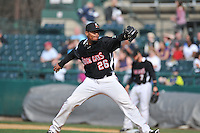 Jose Ortega (26) of the New Britain Rock Cats pitches during a game between the New Britain Rock Cats and the New Hampshire Fisher Cats at New Britain Stadium on April 19, 2015 in New Britain, Connecticut.<br /> (Gregory Vasil/Four Seam Images)