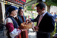 Pictured: Greek Prime Minister Alexis Tsipras tries local delicacies at Prespa Lake in northern Greece. Sunday 17 June 2018<br /> Re: Greece and the Former Yugoslav Republic Of Macedonia (FYROM) have signed a deal that aims to settle a decades-long dispute over the country's name.<br /> Under the agreement, Greece's neighbour will be known as North Macedonia.<br /> Heated rows over Macedonia's name have been going on since the break-up of the former Yugoslavia, of which it was a part, and have held up Macedonia's entry to Nato and the EU.<br /> Greece has long argued that by using the name Macedonia, its neighbour was implying it had a claim on the northern Greek province also called Macedonia.<br /> The two countries' leaders, Mr Tsipras and his Macedonian counterpart Zoran Zaev announced the deal on Tuesday and have pressed ahead despite protests.<br /> The two countries' foreign ministers signed the deal on Lake Prespa on Greece's northern border on Sunday.<br /> The agreement still needs to be approved by both parliaments and by a referendum in Macedonia.