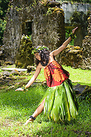 Young kahiko hula dancer at Hawaiian cultural site.