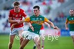 Paul O'Shea Kerry goes past  Cork's Niall Hartnett during the U20 MFC game in Pairc Uí Caoimh last Thursday evening