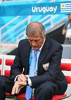 Uruguay coach Oscar Tabarez checks his watch before kick off