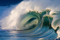 Perfect beautiful wave at the Waimea bay shorebreak during the winter months on the island of Oahu, Hawaii.