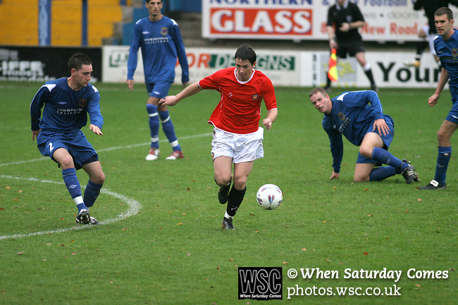 FC United of Manchester 8, Glossop North End 0, 28/10/2006. Gigg LanFC United of Manchester take on Glossop North End (blue shirts) in a North West Counties division one match at United's home stadium, Gigg Lane, home to Bury FC. The match was staged on People United Day, an event started in 1999 which brought together fans from across Europe to campaign against racism. FC United were formed in the summer of 2005 by supporters of Manchester United in response to the take over of their club by American millionaire Malcolm Glazer and his family. The club entered the football pyramid at the lowest level with the intention to climbing through the leagues. FCUM won the match 8-0, watched by 3257 spectators. Photo by Colin McPherson.