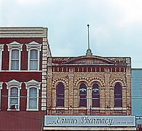 Gonzales:  Commercial buildings. Facade of Erwin's Pharmacy, an 18 Photo '80.