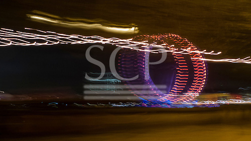 London England. London in a blur of light. Abstract image of the London Eye at night.