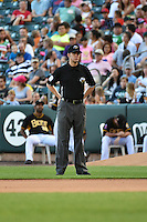 Umpire  Travis Eggert  handles the calls on the bases during the Pacific Coast League game between the Salt Lake Bees and the Reno Aces at Smith's Ballpark on July 23, 2014 in Salt Lake City, Utah.  (Stephen Smith/Four Seam Images)