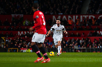 Saturday 11 January 2014 Pictured: Alvaro Vasquez plays the ball past Patrice Evra  of Manchester United<br /> Re: Barclays Premier League Manchester Utd v Swansea City FC  at Old Trafford, Manchester