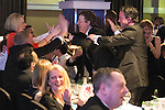 © Joel Goodman - 07973 332324 . 05/03/2015 .  Midland Hotel , Manchester , UK . Winner Eversheds LLP walk to the stage to collect their award . Large Law Firm of the Year . The Manchester Legal Awards 2015 . Photo credit : Joel Goodman
