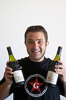 Thierry Usseglio, son of Pierre, who runs the domaine with his brother Jean-Pierre. Domaine Pierre Usseglio, Chateauneuf-du-Pape. Rhone. Owner winemaker. France Europe. Bottle.