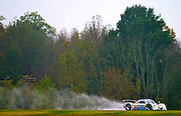 The #10 Chevrolet Dallara of Max Angelelli, Ricky Taylor and Wayne Taylor races past fall foliage and throws up a roostertail in the rain during the Grand-Am Rolex Series test at Virginia International Raceway, Alton, VA , October 2010. (Photo by Brian Cleary/www.bcpix.com)