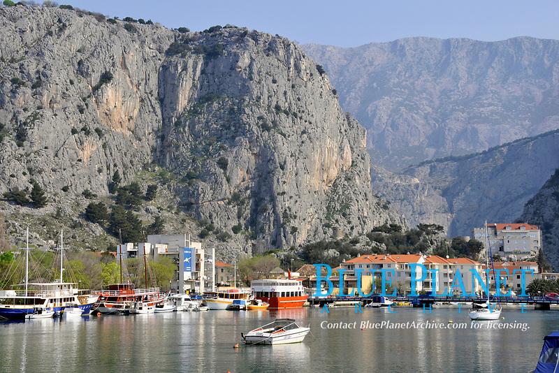 Boats, harbour and cliff, Dalmatian coastal town of Omis, Croatia